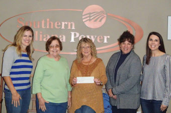 Group of 5 women holding a check for Friend Lincoln Pioneer Village