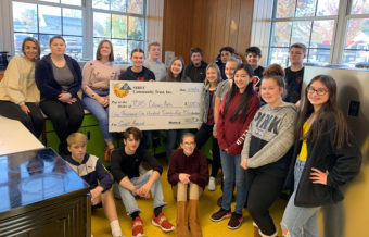 Group of students in a classroom holding a large check for the TCHS Culinary Arts