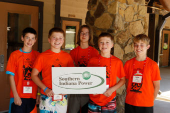Young kids holding a Southern Indiana Power sign.